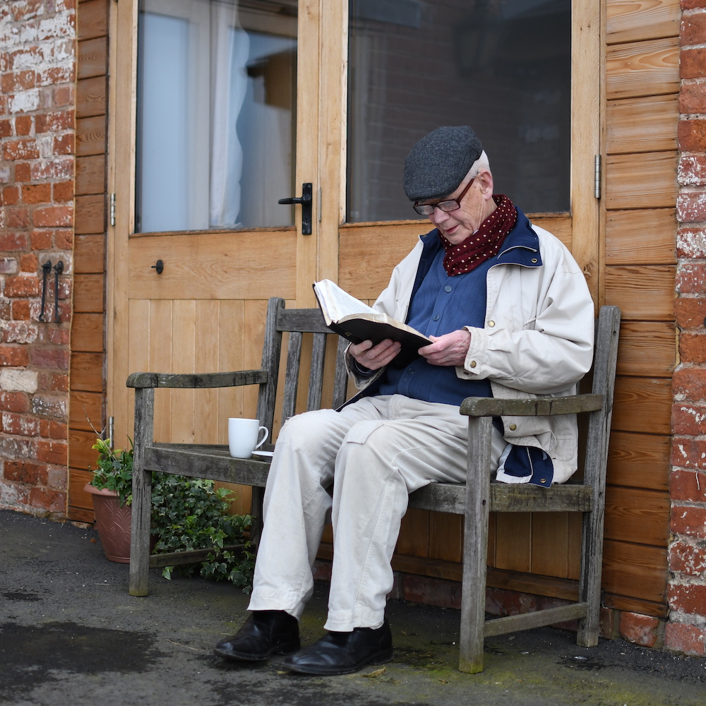Elderly Plymouth Brethren member reading the Bible